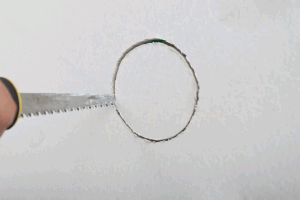 Cutting a round hole in the wall
