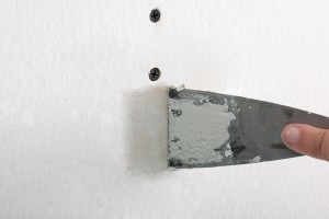 How to patch screw holes in drywall